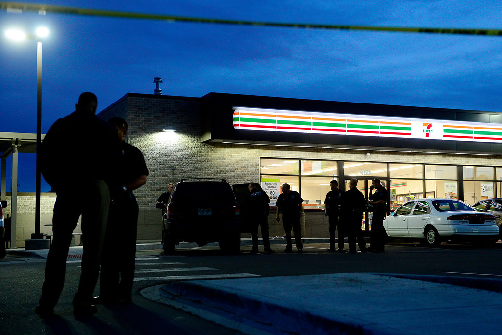 . DENVER, CO - APRIL 29: Officers investigate the SUV that transported the victim to the 7-Eleven near 6th and Federal Boulevard after the boy was shot nearby. The child who was shot was reported to be in critical condition. (Photo by AAron Ontiveroz/The Denver Post)