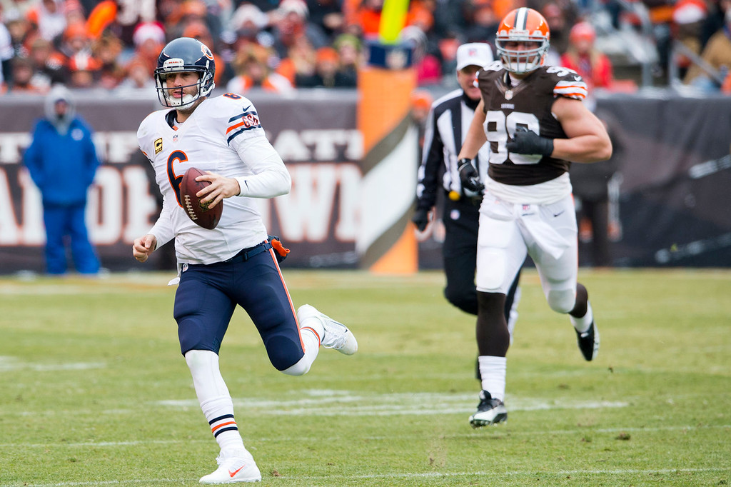 . Outside linebacker Paul Kruger #99 of the Cleveland Browns chases quarterback Jay Cutler #6 of the Chicago Bears  out of the pocket during the first half at FirstEnergy Stadium on December 15, 2013 in Cleveland, Ohio. (Photo by Jason Miller/Getty Images)