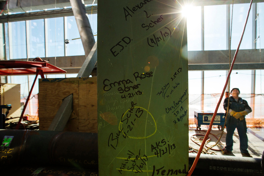 . Graffiti is written on a steel girder on the 105th floor of One World Trade Center after the final piece of the building\'s spire was attached in New York May 10, 2013. Workers cheered and whistled as they completed the spire on New York\'s One World Trade Center on Friday, raising the building to its full height of 1,776 feet and helping fill a void in the skyline left by the September 11, 2001 attacks. REUTERS/Lucas Jackson