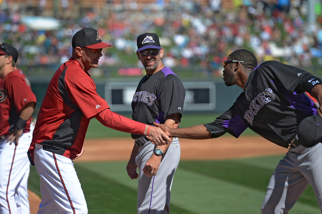 . SCOTTSDALE, AZ. - FEBRUARY 23: Dexter Fowler (24) of the Colorado Rockies shakes hands with Kirk Gibson (23) of the Arizona Diamondbacks as Walt Weiss (22) of the Colorado Rockies looks on during player introductions  February 23, 2013 in Scottsdale. (Photo By John Leyba/The Denver Post)