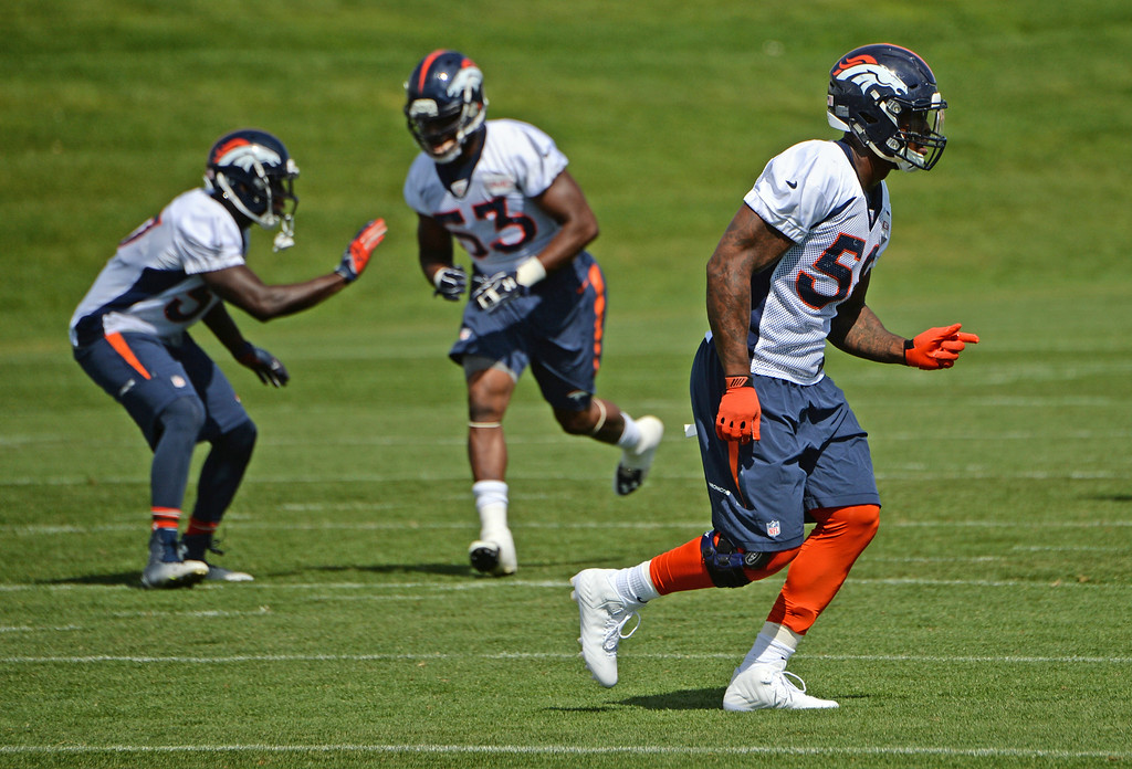 . Von Miller, right, practices at Dove Valley in Centennial, August 21, 2014. The Denver Broncos take on the Houston Texans, in Denver on Saturday, in their third pre-season game. (Photo by RJ Sangosti/The Denver Post)