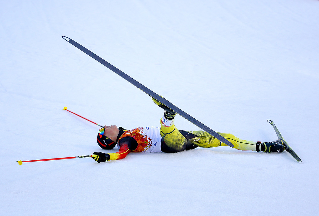 . Eric Frenzel of Germany collapses as he wins the gold medal during the Nordic Combined Individual Gundersen Normal Hill and 10km Cross Country on day 5 of the Sochi 2014 Winter Olympics at the RusSki Gorki Nordic Combined Skiing Stadium on February 12, 2014 in Sochi, Russia.  (Photo by Al Bello/Getty Images)