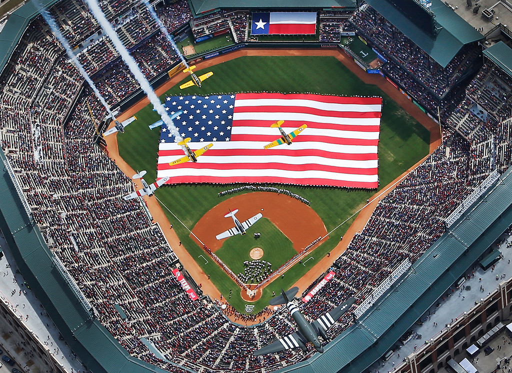 . Vintage planes from the Cavanaugh Flight Museum flyover Globe Life Park during opening day ceremonies before a baseball game between the Texas Rangers and Philadelphia Phillies in Arlington, Texas, Monday, March 31, 2014.  (AP Photo/The Dallas Morning News, Louis DeALuca )