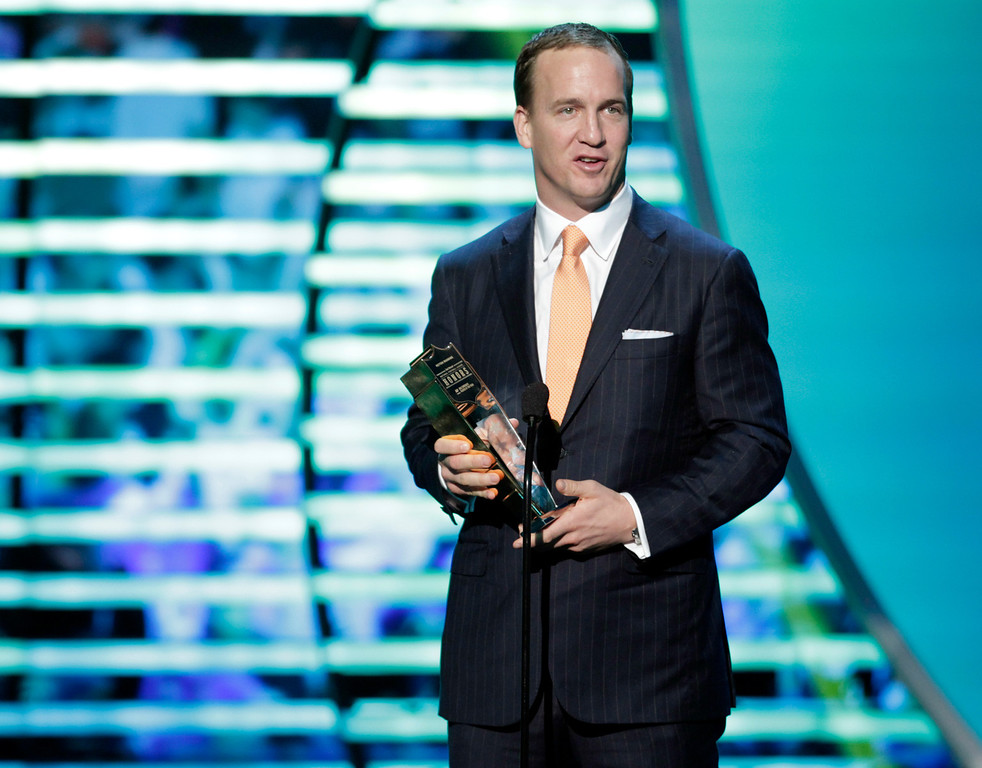 . Peyton Manning of the Denver Broncos accepts the AP Comeback Player of the Year award presented by Lenovo at the 2nd Annual NFL Honors on Saturday, Feb. 2, 2013 in New Orleans. (Photo by AJ Mast/Invision/AP)