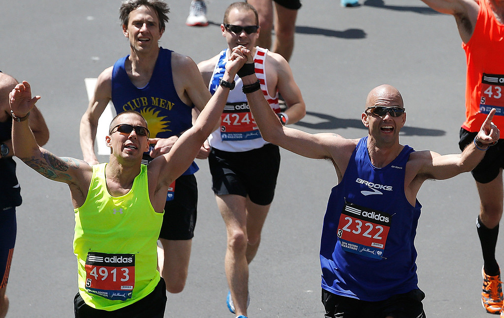 . Runners participate at the finish line in the 2014 B.A.A. Boston Marathon on April 21, 2014 in Boston, Massachusetts.  (Photo by Jim Rogash/Getty Images)