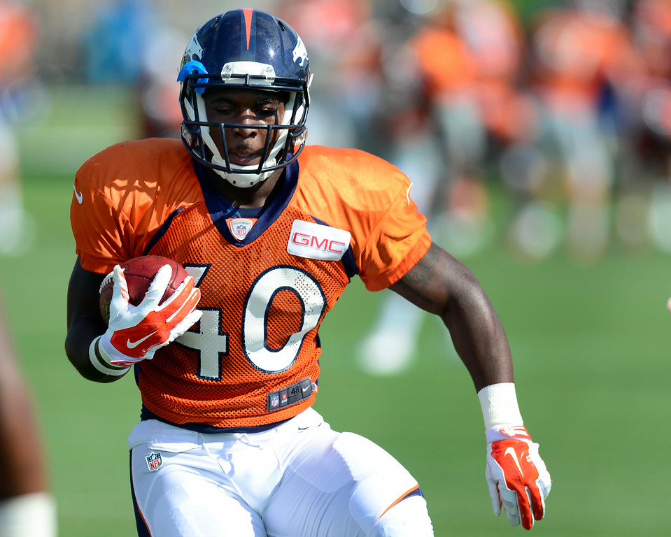 . Juwan Thompson (40) runs through drills on Saturday. The Denver Broncos football team hold their workouts for the team during mini-camp at Dove Valley in Centennial on Saturday, July 26, 2014. (Photo by Kathryn Scott Osler/The Denver Post)
