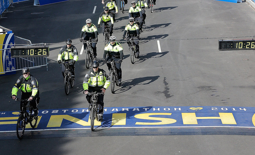 . Police on bicycles ride the route before the start of the 2014 B.A.A. Boston Marathon on April 21, 2014 in Boston, Massachusetts.  (Photo by Jim Rogash/Getty Images)