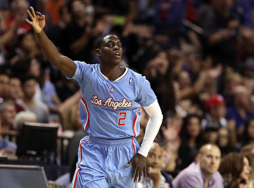 . The Los Angeles Clippers\' Darren Collison celebrates after sinking a 3-point shot during overtime of a preseason NBA basketball game against the Denver Nuggets on Saturday, Oct. 19, 2013, in Las Vegas. The Clippers defeated the Nuggets in overtime 118-111. (AP Photo/Isaac Brekken)