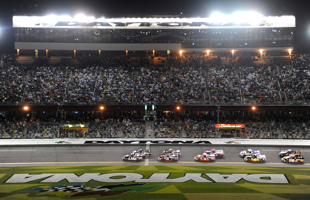 . Trucks take the green flag to start the NASCAR Camping World Truck Series NextEra Energy Resources 250 race at the Daytona International Speedway in Daytona Beach, Florida February 22, 2013. The Daytona 500 NASCAR Sprint Cup race is scheduled for February 24.  REUTERS/Brian Blanco