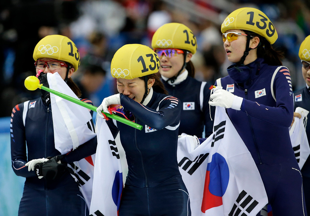 . The South Korean team celebrate their win in the women\'s 3000m short track speedskating relay final at the Iceberg Skating Palace during the 2014 Winter Olympics, Tuesday, Feb. 18, 2014, in Sochi, Russia. (AP Photo/David J. Phillip )