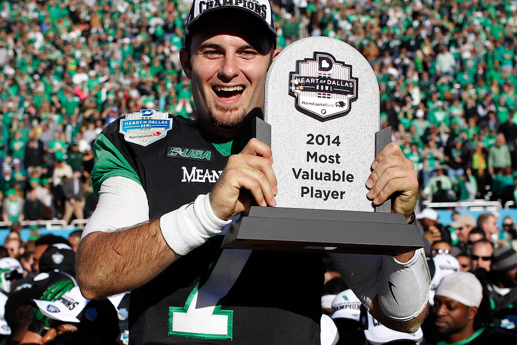 . DALLAS, TX - JANUARY 01:  Senior quarterback Derek Thompson #7 of the North Texas Mean Green receives the MVP award after the Heart of Dallas Bowl against the UNLV Rebels at Cotton Bowl Stadium on January 1, 2014 in Dallas, Texas. The North Texas Mean Green defeated the UNLV Rebels 36-14.  (Photo by Sarah Glenn/Getty Images)