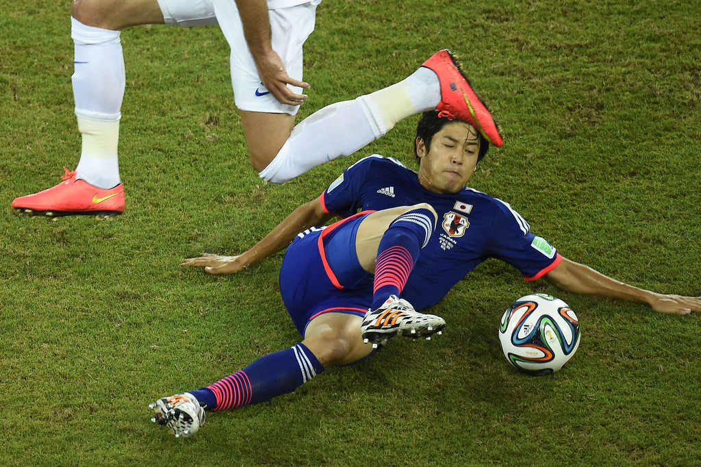 . Japan\'s defender Atsuto Uchida in action during a Group C match between Japan and Greece at the Dunas Arena in Natal during the 2014 FIFA World Cup on June 19, 2014. ODD ANDERSEN/AFP/Getty Images