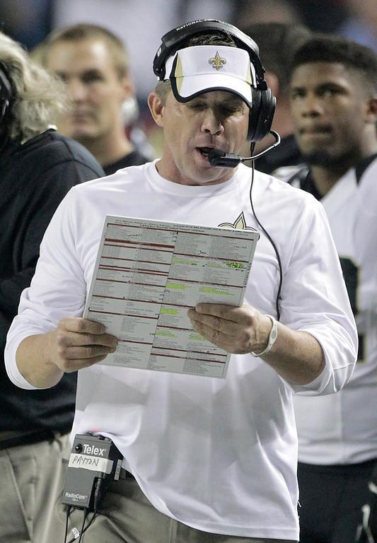 . New Orleans Saints head coach Sean Payton looks at plays against the Atlanta Falcons during the first half of an NFL football game, Thursday, Nov. 21, 2013, in Atlanta. (AP Photo/Dave Martin)