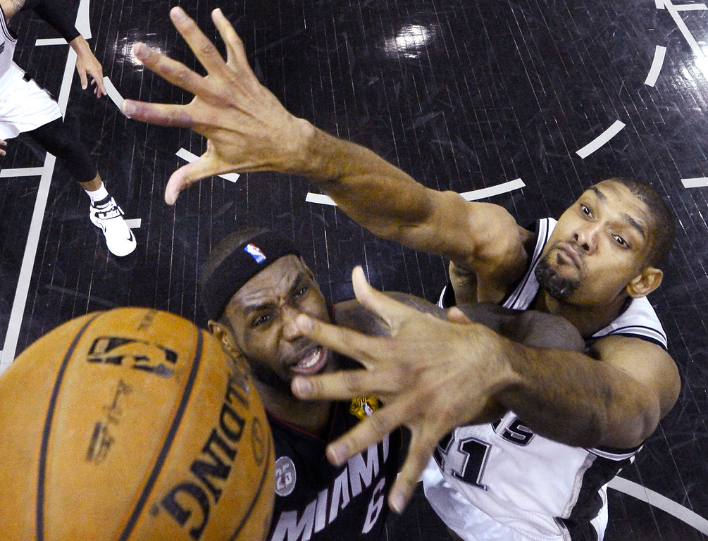 . Miami Heat\'s LeBron James (6) tries to shoot against San Antonio Spurs\' Tim Duncan (21) during the first half at Game 4 of the NBA Finals basketball series, Thursday, June 13, 2013, in San Antonio. (AP Photo/Derick E. Hingle, Pool)