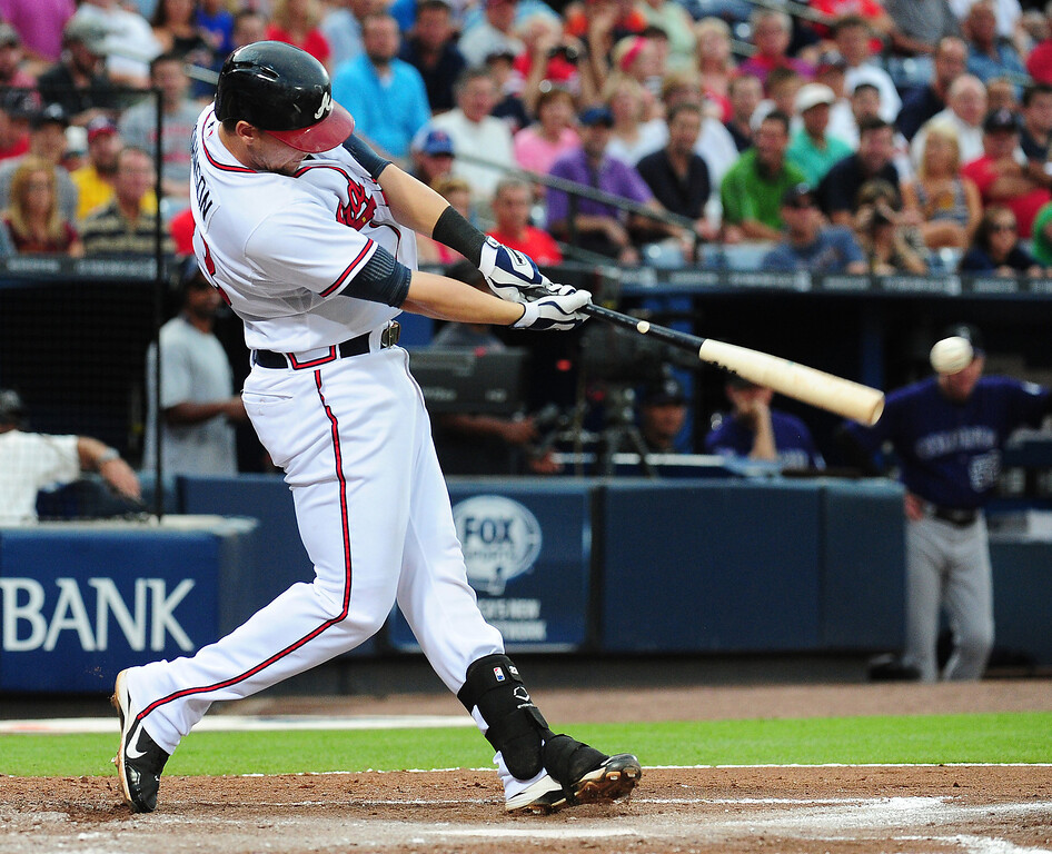 . Chris Johnson #23 of the Atlanta Braves hits a two run double in the third inning against the Colorado Rockies at Turner Field on July 29, 2013 in Atlanta, Georgia. (Photo by Scott Cunningham/Getty Images)