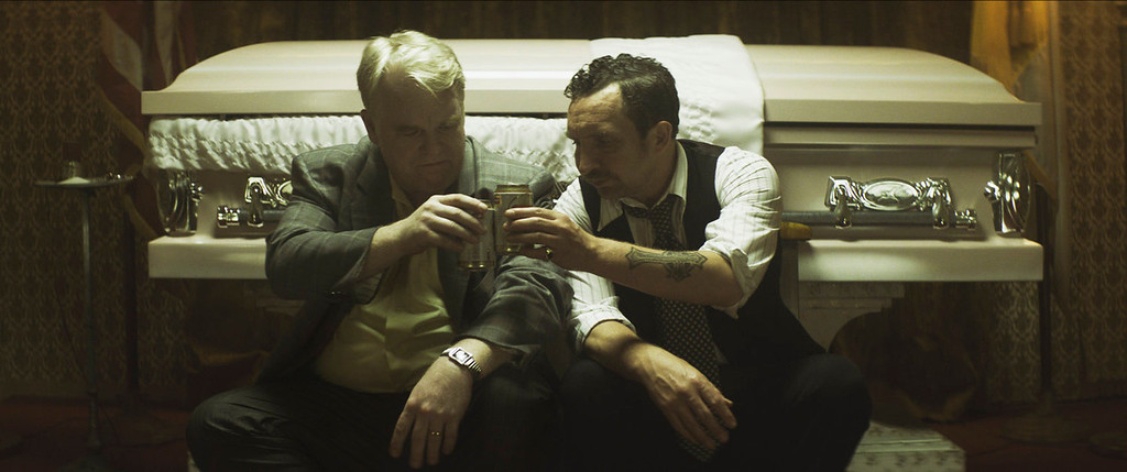". This photo provided by the Sundance Institute shows, Philip Seymour Hoffman, left, and Eddie Marsan, in a scene from the film, ""God\'s Pocket.\"" The Sundance Film Festival runs Jan. 16-26, 2014, in Park City, Utah.  (AP Photo/Sundance Institute, Lance Acord)"