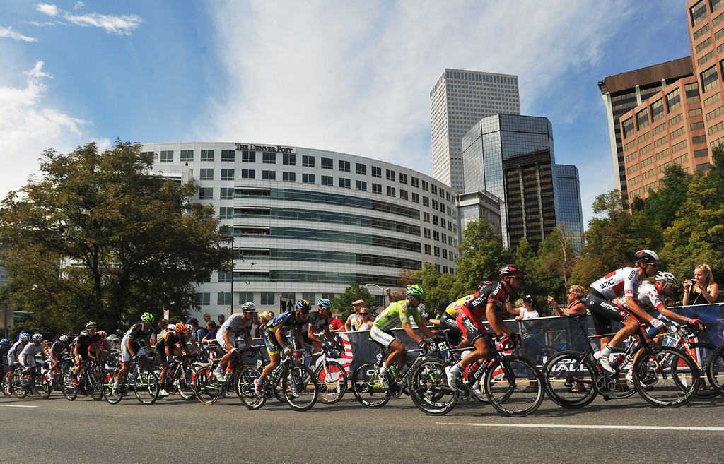 . Cyclists ride through downtown Denver during the 75-mile 7th stage of the 2013 USA Pro Challenge race in Denver, Colorado on August 25, 2013. (Photo by Hyoung Chang/The Denver Post)