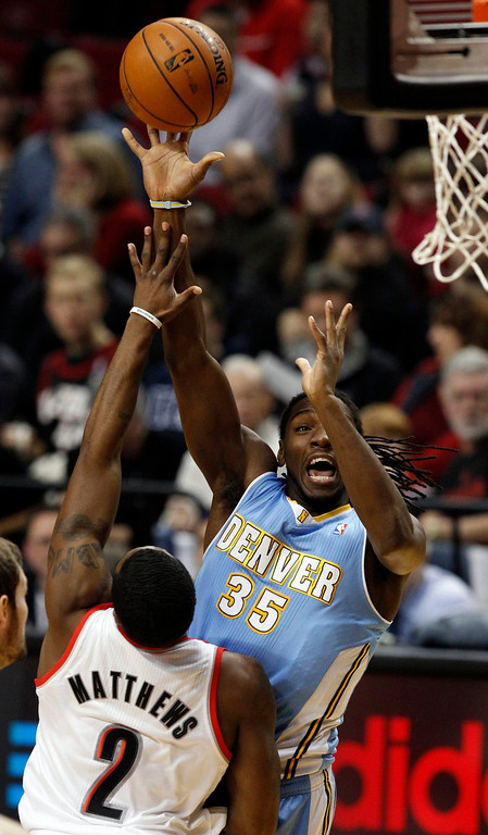 . Denver Nuggets small forward Kenneth Faried (35) shoots over Portland Trail Blazers shooting guard Wesley Matthews (2) during first quarter of their NBA basketball game in Portland, Oregon, December 20, 2012.  REUTERS/Steve Dipaola