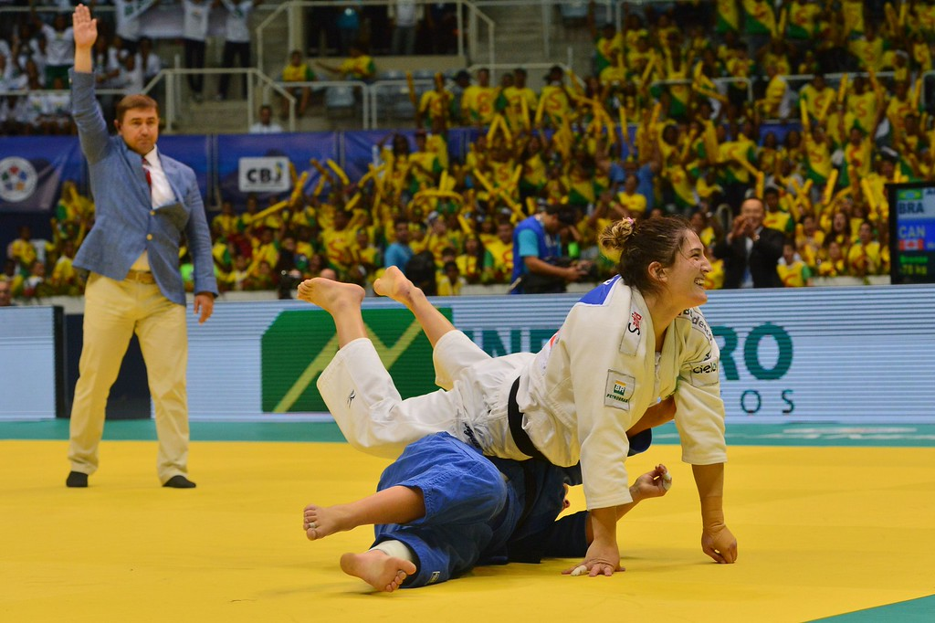 . Brazil\'s Mayra Aguiar (white) reacts after winning the bronze against Canada\'s Catherine Roberge in the -78kg category, during the IJF World Judo Championship, in Rio de Janeiro, Brazil, on August 30, 2013. YASUYOSHI CHIBA/AFP/Getty Images