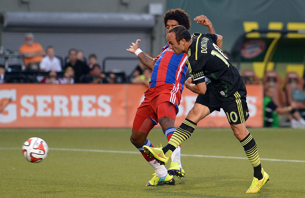 . Landon Donovan of MLS All-Stars scores his teams second goal against Dante of Muenchen during the MLS All-Star game between the MLS All-Stars and FC Bayern Muenchen at Providence Park on August 6, 2014 in Portland, Oregon.  (Photo by Lars Baron/Bongarts/Getty Images)