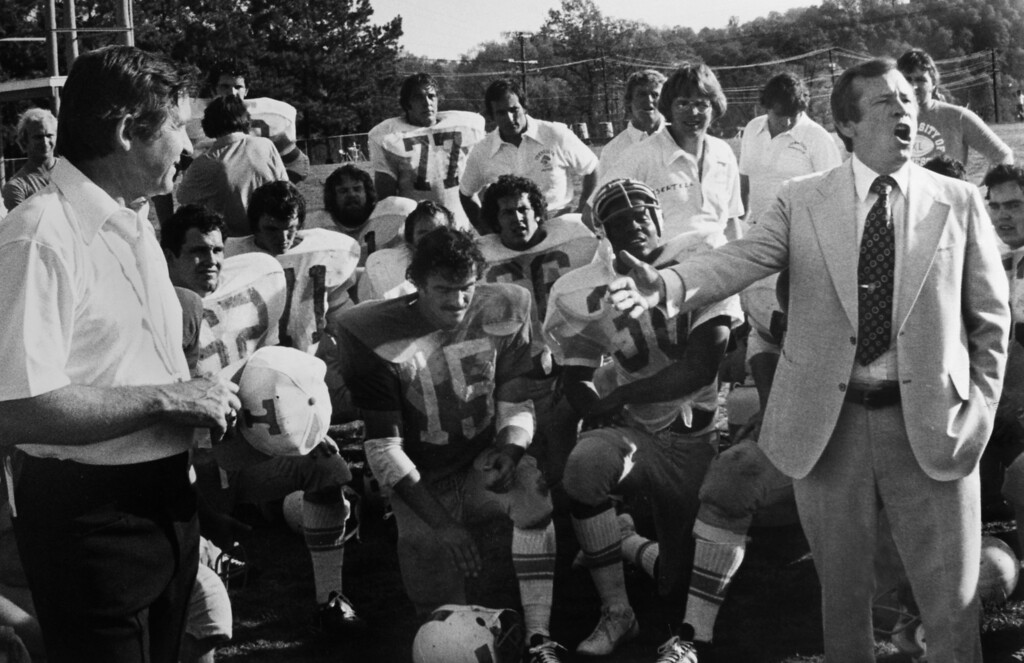. FILE - In an April 11, 1977, file photo,  U.S. Sen. Howard H. Baker, Jr., right, encourages the University of Tennessee football team as coach Johnny Majors, left, listens in Knoxville, Tenn. Baker died Thursday from complications from a stroke in his hometown of Huntsville, Tenn, at age 88. (AP Photo/Knoxville News Sentinel, File)