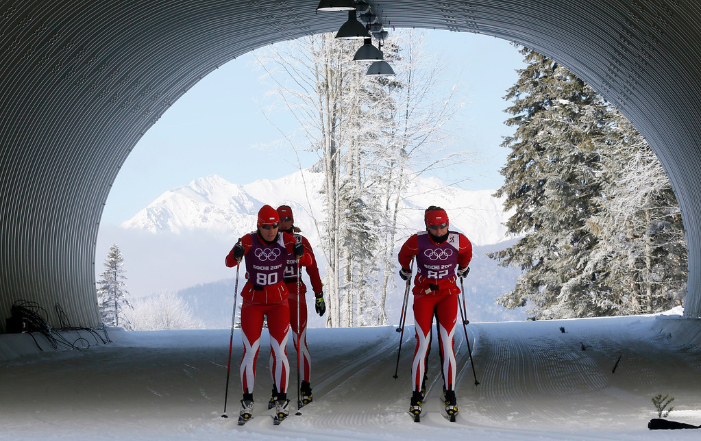 . Poland\'s Sylwia Jaskowiec, left, and Kornelia Kubinska train with their teammates on the cross country track prior to the 2014 Winter Olympics, Wednesday, Feb. 5, 2014, in Krasnaya Polyana, Russia. (AP Photo/Dmitry Lovetsky)
