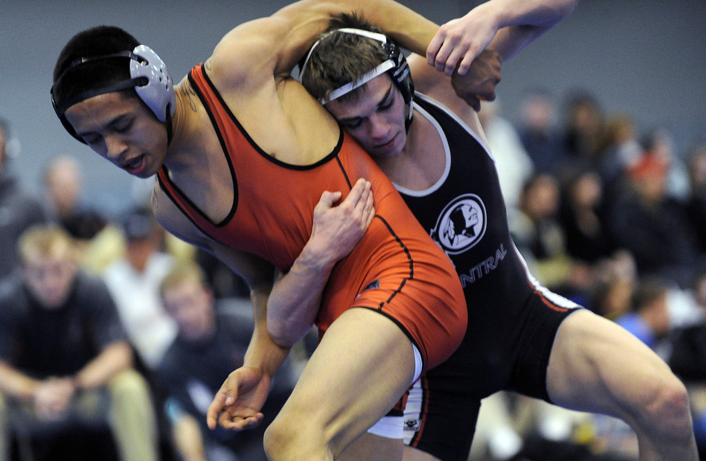 . Bryce Meredith of Chyennne Central, right, controls Raymond Robledo of Pomona during the 132 pound final of Northern Colorado Christmas Tournament at Island Grove Event Center in Greeley, Colo., on Saturday, Dec. 22, 2012. Meredith won the match. Hyoung Chang, The Denver Post