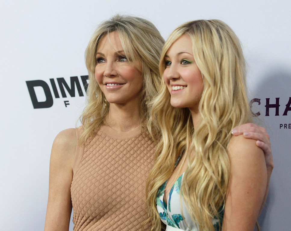 """. Actress Heather Locklear (L) and her daughter Ava Sambora arrive at the premiere of the film \""""Scary Movie 5\"""" in Hollywood April 11, 2013. REUTERS/Fred Prouser"""
