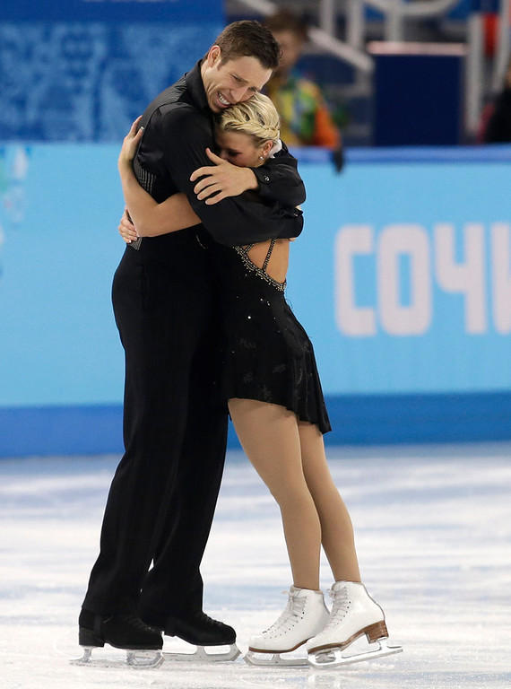 . Kirsten Moore-Towers and Dylan Moscovitch of Canada embrace after finishing their routine in the pairs free skate figure skating competition at the Iceberg Skating Palace during the 2014 Winter Olympics, Wednesday, Feb. 12, 2014, in Sochi, Russia. (AP Photo/Darron Cummings)