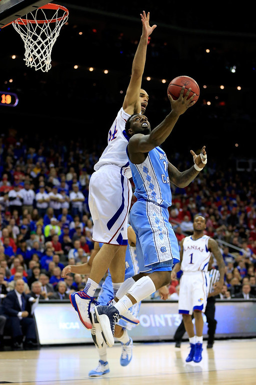 . P.J. Hairston #15 of the North Carolina Tar Heels drives for a shot attempt in the first half against Perry Ellis #34 of the Kansas Jayhawks during the third round of the 2013 NCAA Men\'s Basketball Tournament at Sprint Center on March 24, 2013 in Kansas City, Missouri.  (Photo by Jamie Squire/Getty Images)