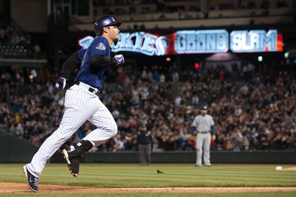 . DENVER, CO - MAY 4:  Nolan Arenado #28 of the Colorado Rockies circles the bases after hitting a grand slam home run in the seventh inning of a game against the Tampa Bay Rays at Coors Field on May 4, 2013 in Denver, Colorado.  (Photo by Dustin Bradford/Getty Images)