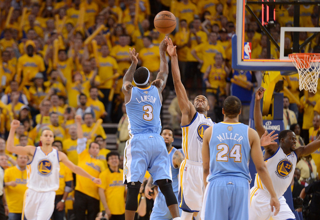 . Ty Lawson (3) of the Denver Nuggets shoots a late shot with no time on the clock over Jarrett Jack (2) of the Golden State Warriors in the fourth quarter in Game 6 of the first round NBA Playoffs May 2, 2013 at Oracle Arena. (Photo By John Leyba/The Denver Post)