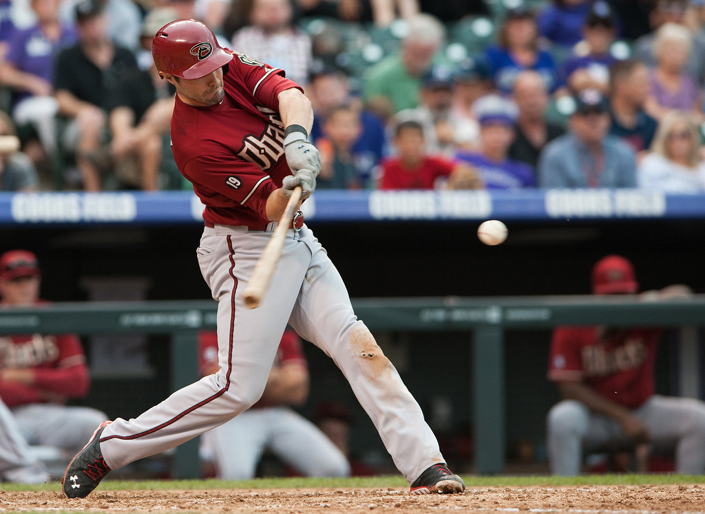 . A.J. Pollock #11 of the Arizona Diamondbacks hits an RBI double in the sixth inning of a game against the Colorado Rockies at Coors Field on September 22, 2013 in Denver, Colorado.  (Photo by Dustin Bradford/Getty Images)