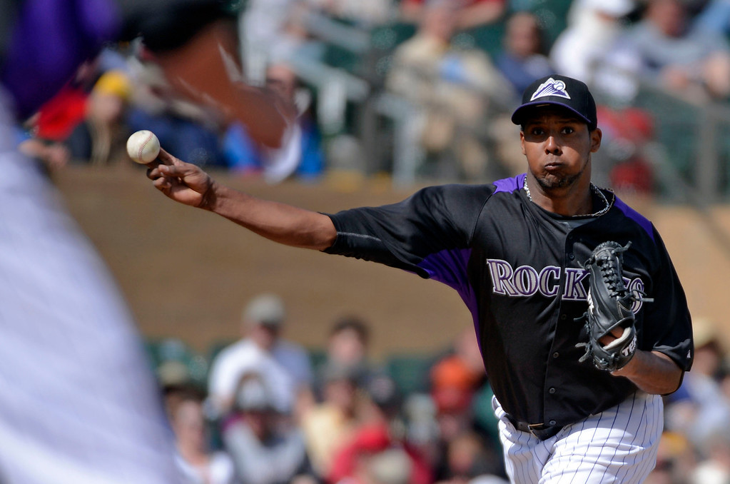 . SCOTTSDALE, AZ. - FEBRUARY 24: Juan Nicasio (44) of the Colorado Rockies throws over to first base during the fourth inning of their game against the Arizona Diamondbacks February 24, 2013 in Scottsdale. (Photo By John Leyba/The Denver Post)