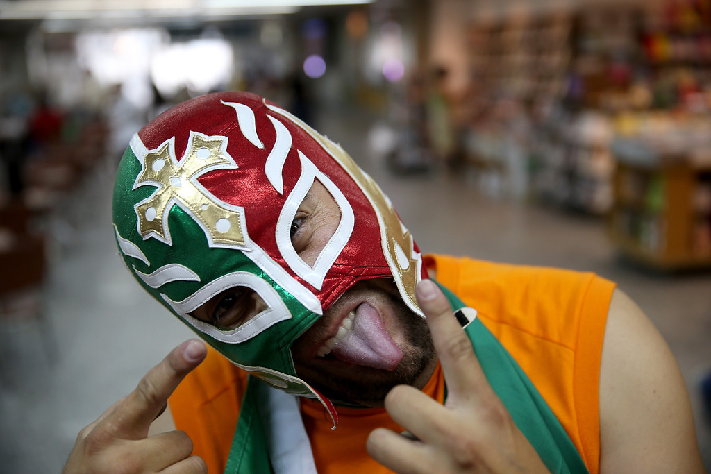 . Mexican soccer fan, Herwin Gomez, from Mexico, wears a Lucha libre mask as he arrives at the Rio de Janeiro Galeao International Airport for the World Cup tournament on June 10, 2014 in Rio de Janeiro, Brazil.   Brazil continues to prepare to host the World Cup which starts on June 12th and runs through July 13th.  (Photo by Joe Raedle/Getty Images)