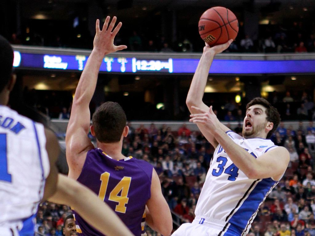 . Duke Blue Devils\' Ryan Kelly (34) shoots over the defense of Albany Great Danes\' Sam Rowley (14) during the first half of their second round NCAA tournament game in Philadelphia, Pennsylvania, March 22, 2013. REUTERS/Tim Shaffer