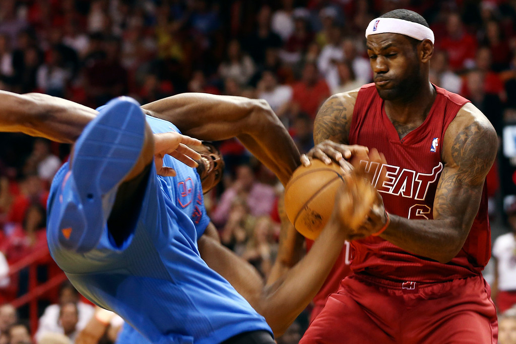 . Oklahoma City Thunder\'s Serge Ibaka (9) and Miami Heat\'s LeBron James (6) battle for the ball during the second half of an NBA basketball game in Miami, Tuesday, Dec. 25, 2012. The Heat won 103-97. (AP Photo/J Pat Carter)