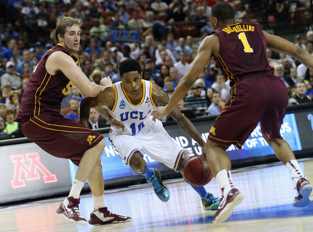 . AUSTIN, TX - MARCH 22:  Larry Drew II #10 of the UCLA Bruins tries to get through Elliott Eliason #55 and Andre Hollins #1 of the Minnesota Golden Gophers during the second round of the 2013 NCAA Men\'s Basketball Tournament at The Frank Erwin Center on March 22, 2013 in Austin, Texas.  (Photo by Stephen Dunn/Getty Images)