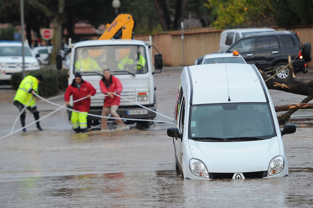 """. Rescue workers are seen in the harbour of La Londe-les-Maures, southeastern France, on Januray 20, 2014. River levels were receding early today in southeastern France after \""""historic\"""" floods left two people dead and more than 150 were airlifted to safety. A third man disappeared while out on his boat and 4,000 homes have been left without power after the deluge in the department of Var, they said. Local official Laurent Cayrel said one of the victims, a 73-year-old man, died in his basement, while the other was swept away in his car.  BORIS HORVAT/AFP/Getty Images"""