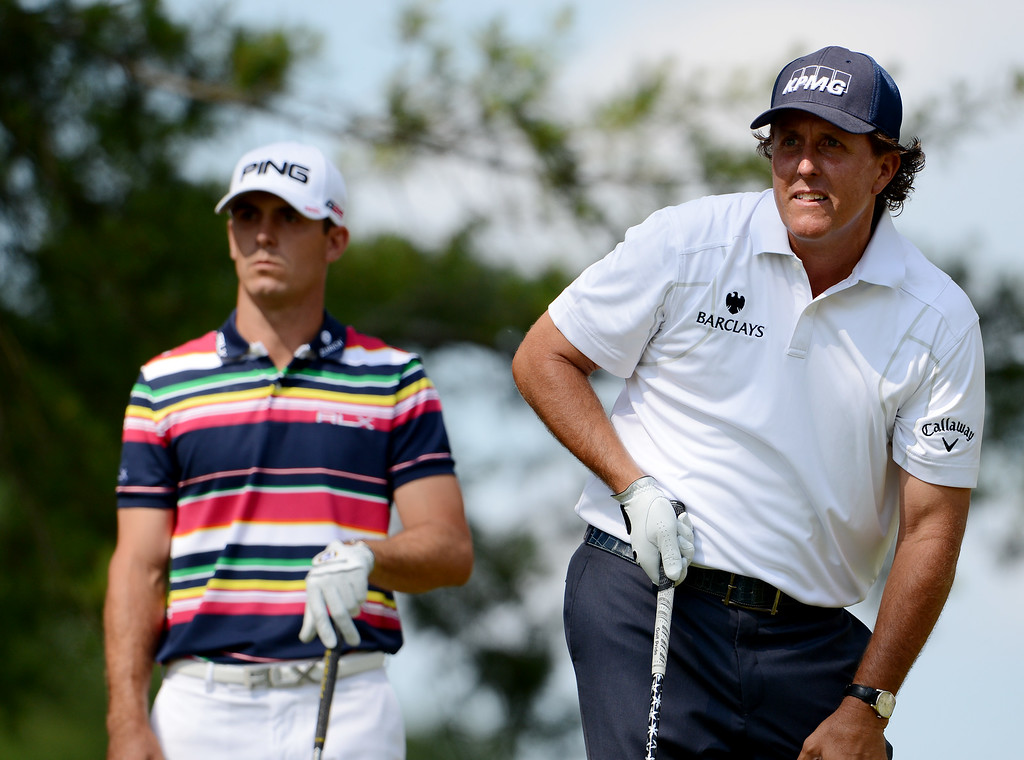 . Phil Mickelson (R) of the United States watches his tee shot on the fifth tee as Billy Horschel (L) of the United States looks on during Round Three of the 113th U.S. Open at Merion Golf Club on June 15, 2013 in Ardmore, Pennsylvania.  (Photo by David Cannon/Getty Images)