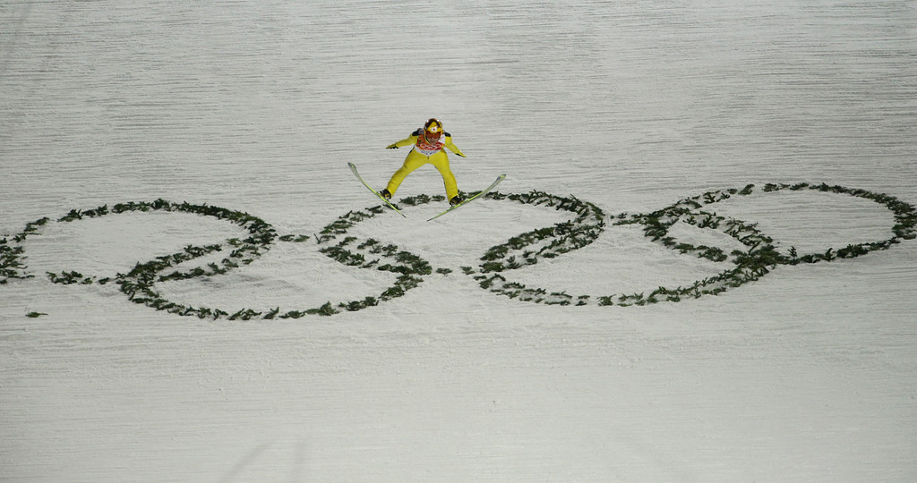 . Japan\'s Noriaki Kasai makes an attempt during the men\'s normal hill ski jumping qualification at the 2014 Winter Olympics, Saturday, Feb. 8, 2014, in Krasnaya Polyana, Russia. (AP Photo/Gregorio Borgia)