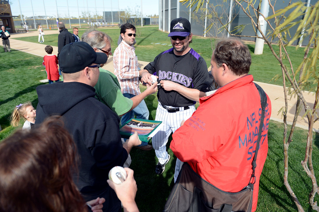 . SCOTTSDALE, AZ. - FEBRUARY 19: Colorado Rockies Todd Helton (17) signs autographs for fans during a break between drills during Spring Training February 19, 2013 in Scottsdale. (Photo By John Leyba/The Denver Post)