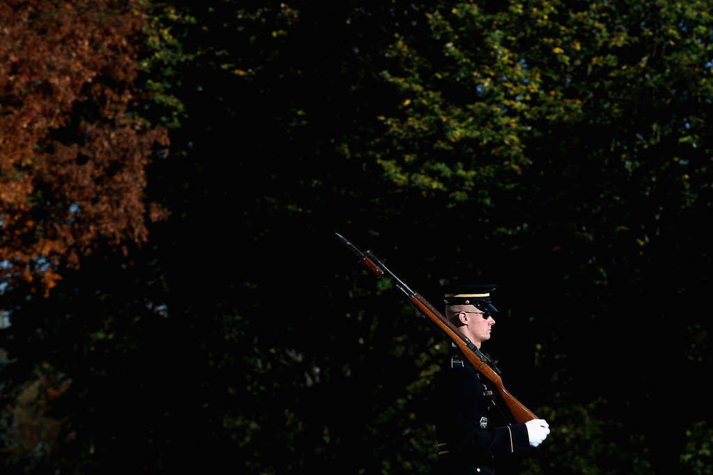 . A member of the military color guard stands at attention before a ceremony where U.S. President Barack Obama will lay a commemorative wreath for Veterans Day at the Tomb of the Unknowns at Arlington National Cemetery on November 11, 2013 in Arlington, Virginia. For Veterans Day, President Obama is paying tribute to military veterans past and present who have served and sacrificed their lives for their country.  (Photo by Mark Wilson/Getty Images)