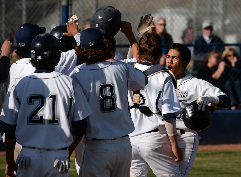 . LITTLETON, CO - APRIL 16,  2014: Columbine Rebels Donny Ortiz, #3, far right, celebrates his fourth inning home run with teammates during their game against the Ralston Valley Mustangs at Columbine High School in Littleton, Co on April 17, 2014. Columbine pitcher Blake Weiman had a great game and was taken out in the fifth inning when the Rebels were up 8 to 1 over the Mustangs. (Photo By Helen H. Richardson/ The Denver Post) 12