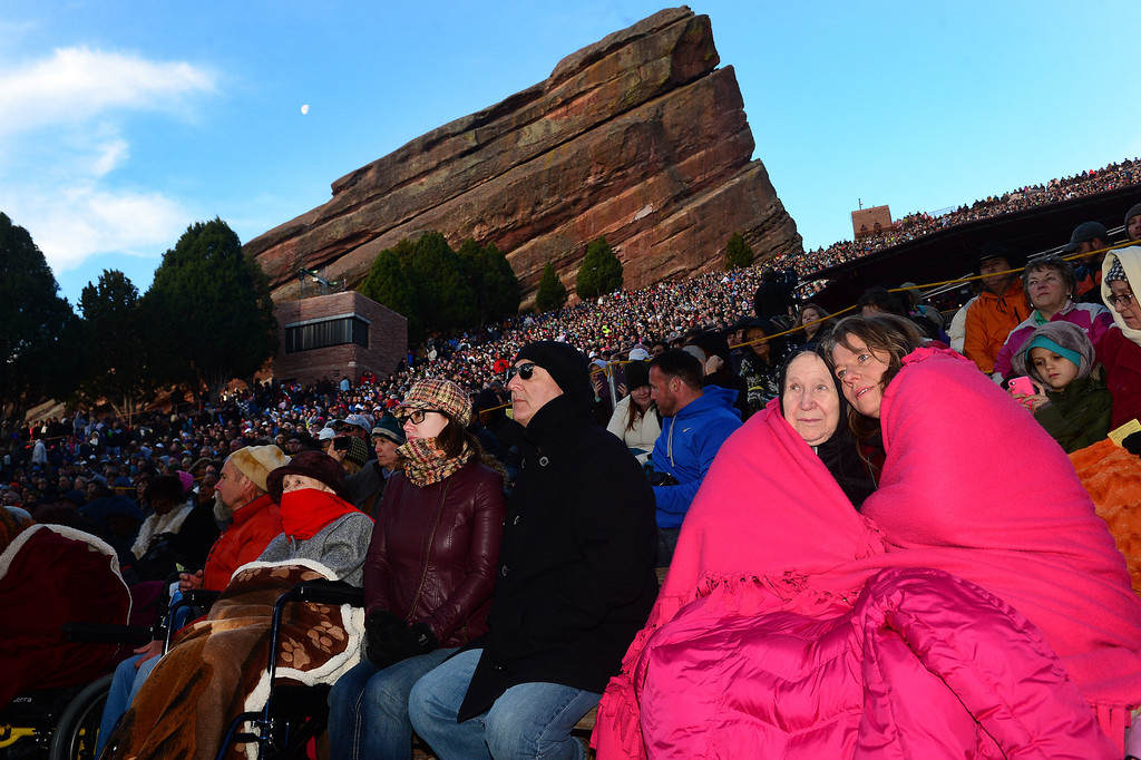 ". Arlene Wiberg, middle, and her daughter Theresa Wiberg, right, stay warm under lots of blankets as the two enjoy  the 67th annual Easter sunrise service  at Red Rocks Amphitheater in Morrison, Colorado, on April 17, 2014.  Superintendent Patrick L. Demmer gave the sermon which was entitled ""What are you looking for?\"".  The popular annual event, which hosts thousands of worshipers, is sponsored by the Colorado Council of Churches.  (Photo By Helen H. Richardson/ The Denver Post)"