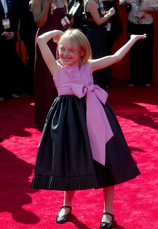 . Actress Dakota Fanning attends the 55th Annual Primetime Emmy Awards at the Shrine Auditorium September 21, 2003 in Los Angeles, California.  (Photo by Kevin Winter/Getty Images)