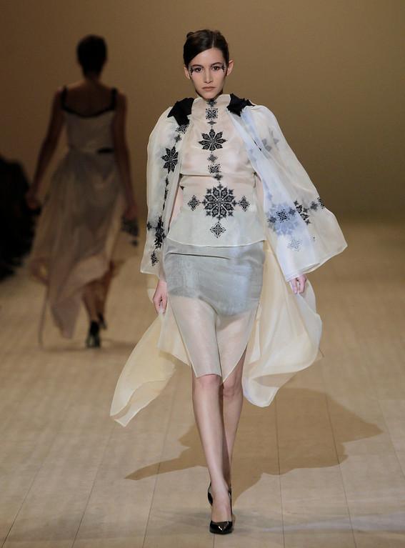 . EDS NOTE: NUDITY - A model displays outfits by Ukrainian designer Olena Datsí during fashion week in Kiev, Ukraine, Sunday, Oct. 13, 2013. (AP Photo/Sergei Chuzavkov)