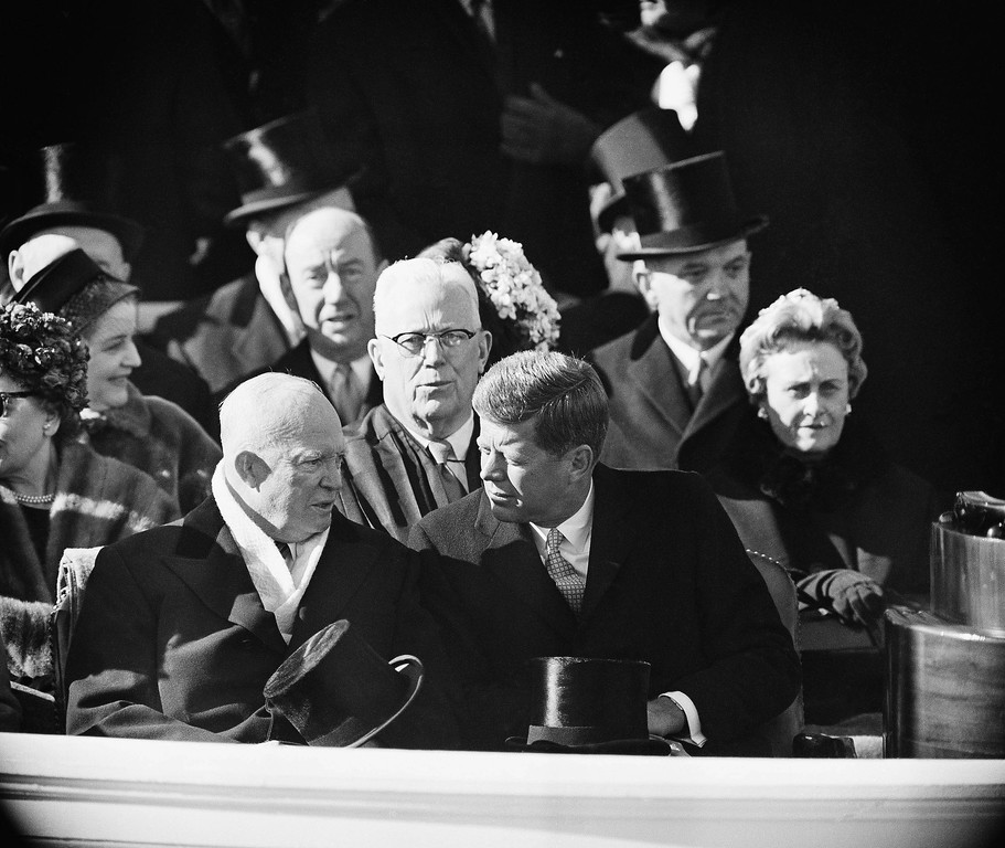 . Kennedy talks and his predecessor, Dwight Eisenhower, chat during an interlude in inaugural ceremonies at the Capitol on Jan. 20, 1961. Associated Press file