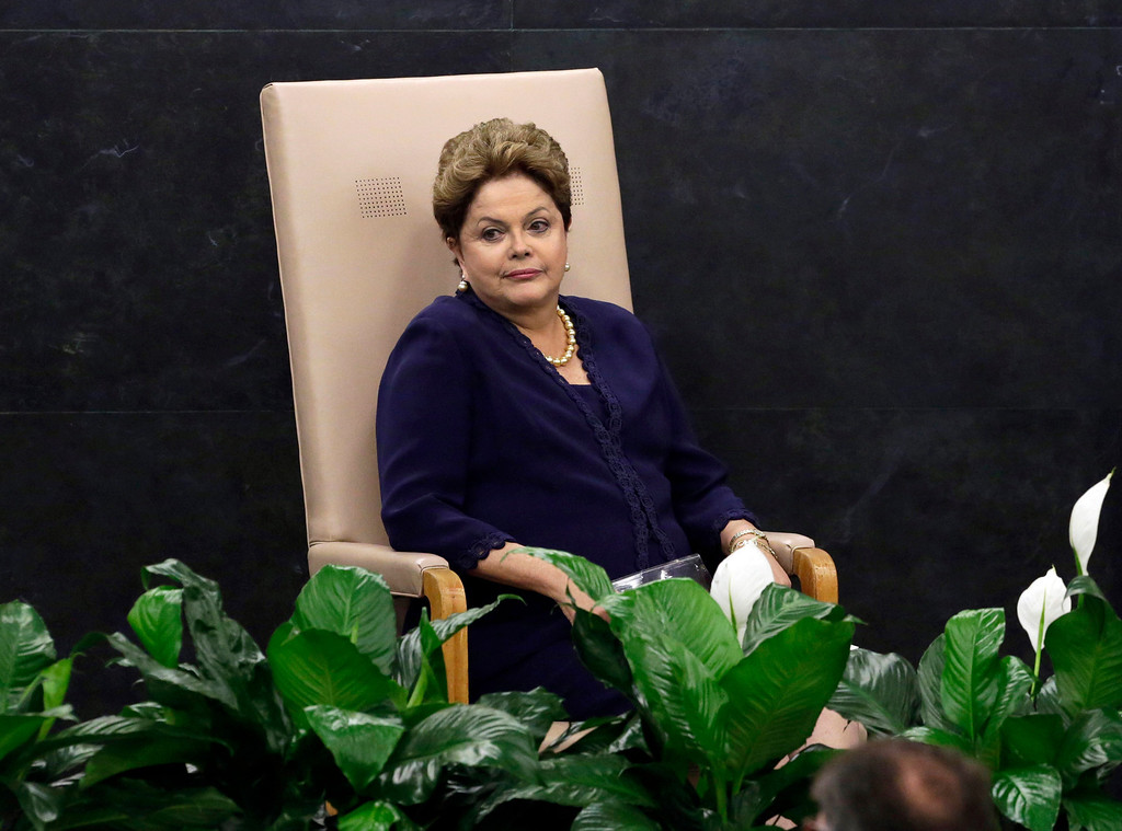 ". In this Tuesday, Sept. 24, 2013 photo, Brazil\'s President Dilma Rousseff waits to be introduced to address the 68th session of the United Nations General Assembly, in New York. Rousseff accused the U.S. of violating Brazil\'s sovereignty with what she called a ""grave violation of human rights and of civil liberties\"" regarding the U.S. National Security Agency surveillance program that has swept up data from telephone calls and emails that have passed through Brazil, including her own. (AP Photo/Richard Drew)"