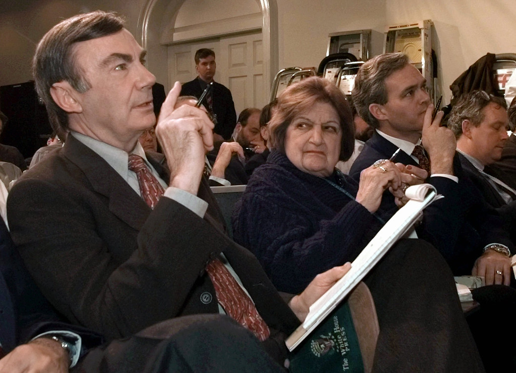 . ABC Television newsman San Donaldson questions White House Press Secretary Mike McCurry during the daily White House briefing in the White House briefing room Monday, Jan. 12, 1998. Donaldson returned to the White House beat after a nine-year absence. Helen Thomas, veteran UPI correspondent and dean of the White House press corps, looks on alongside. (AP Photo/Susan Walsh)